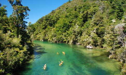 Kayaking over clear river water - Risskov Rejser